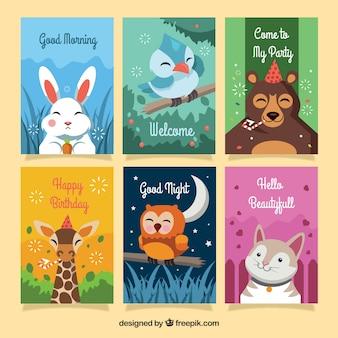 Colección colorida de tarjetas con animales felices