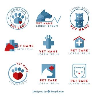 Colección de bonitos logotipos planos de veterinaria