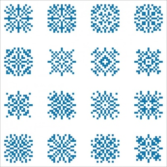 Colección de copos de nieve hechos con píxeles