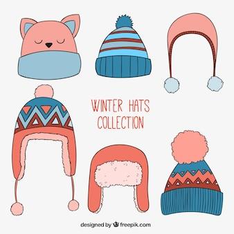 Colección de gorros de invierno en estilo dibujado a mano