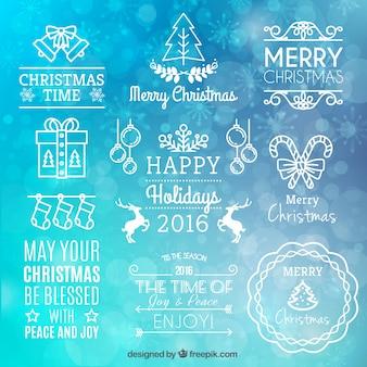 Colección de insignias de navidad blancas en fondo borroso