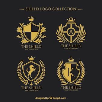 Colección de logos de escudos dorados
