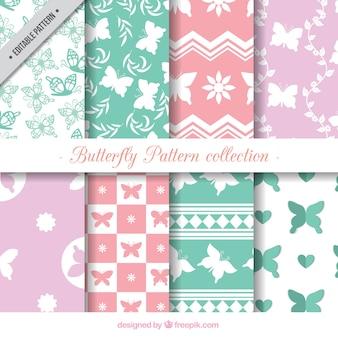 Colección de ocho patrones de mariposas en colores pastel