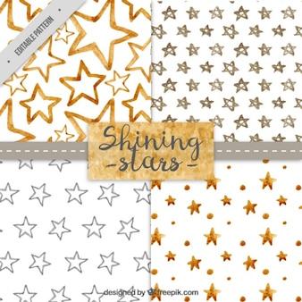 Colección de patrones con estrellas de acuarela