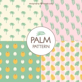 Colección de patrones de palmeras en colores pastel