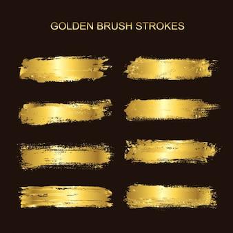 Colección de pinceladas doradas