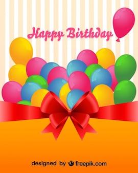 Coloridos globos en tarjeta de felicitación por cumpleaños