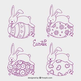 Conejitos de pascua que duerme en los huevos de Pascua