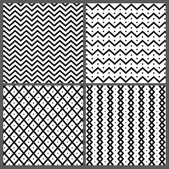 Conjunto de cuatro dibujados a mano patrones abstractos sin fisuras con zigzag, rayas onduladas y líneas texturas.