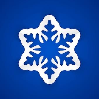Copo de nieve de papel en un fondo azul