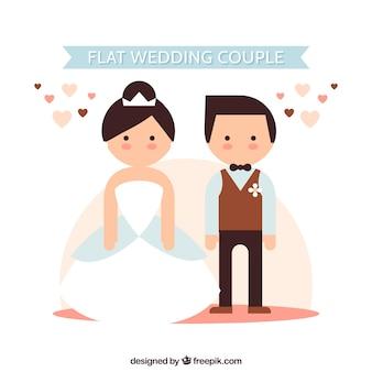 Copuple plana de la boda con los corazones