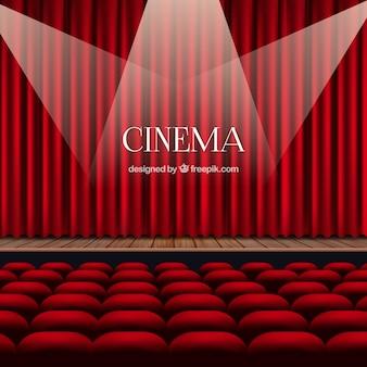 cortinas rojas con focos y sillones