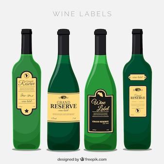 Cuatro botellas de vino con etiquetas decorativas