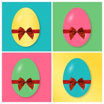 Cuatro huevos de pascua con diferentes colores