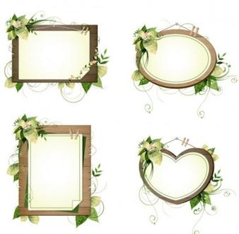 cuatro marcos de madera con decoración floral