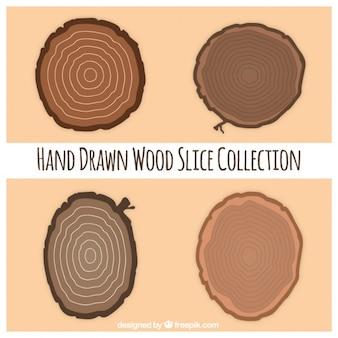 Cuatro rebanadas de madera dibujadas a mano
