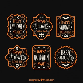 Decorativas insignias de halloween con borde naranja