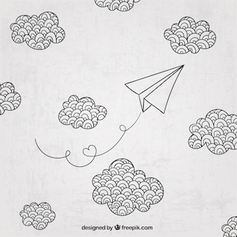 Dibujado a mano avión de papel y las nubes
