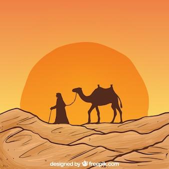 Dibujado a mano paisaje del desierto con la silueta del camello