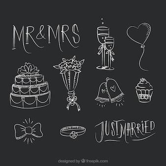 Dibujados a mano elementos de la boda en el estilo de la pizarra