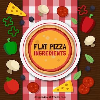 Diferentes ingredientes para la pizza en estilo plano