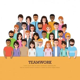 Diferentes personas con un cartel de trabajo en equipo