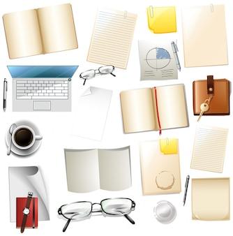 Diferentes suministros de oficina sobre fondo blanco