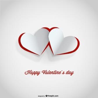 Diseño de tarjeta del día de san valentín con corazones cortados de papel