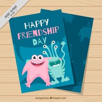Divertida tarjeta del día de la amistad con mostruos