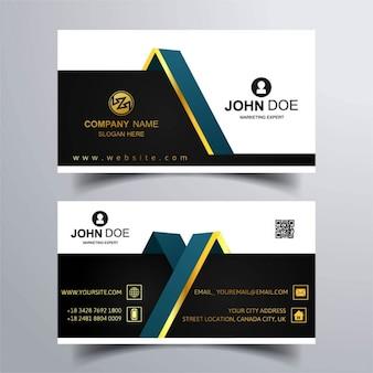 Dos tarjetas de visita con adornos dorados