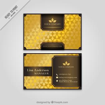 Elegante tarjeta corporativa con formas florales doradas
