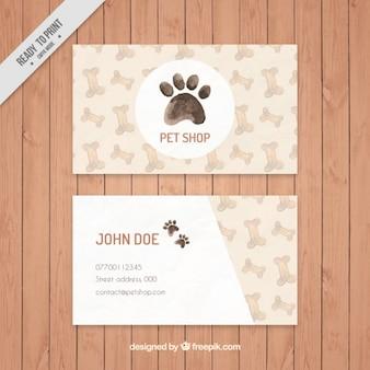 Elegante tarjeta de tienda de mascotas de acuarela con huesos y huella