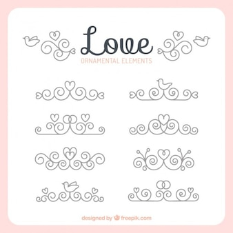 Elementos ornamentales de amor con remolinos y corazones