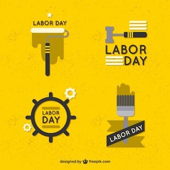 Emblemas amarillos del día del trabajo