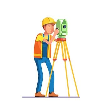 Encuesta de tierra e ingeniero civil trabajando