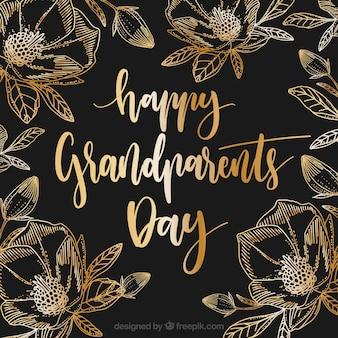 Escritura elegante de feliz día del abuelo con flores doradas