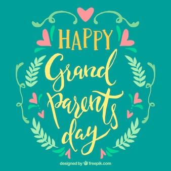 Escritura vintage de feliz día de los abuelos con detalles florales