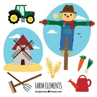 Espantapájaros con elementos de granja