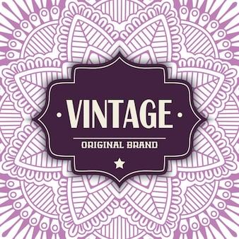 Etiqueta vintage sobre un mandala púrpura