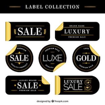 Etiquetas de rebajas de lujo con detalles dorados