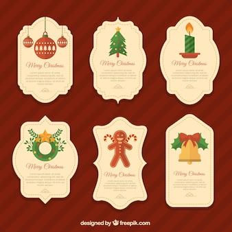 Etiquetas decorativas con elementos navideños en diseño plano