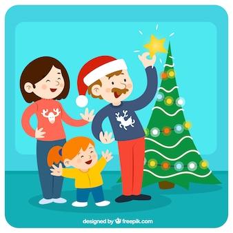 Familia decorando el árbol