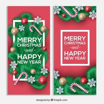 Felicitaciones de navidad y año nuevo con bastones de caramelo