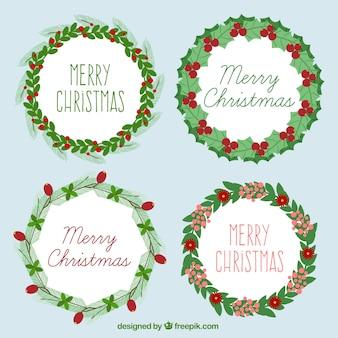 Feliz navidad con un genial paquete de coronas con detalles rojos