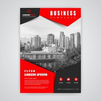 Folleto rojo y negro con edificios