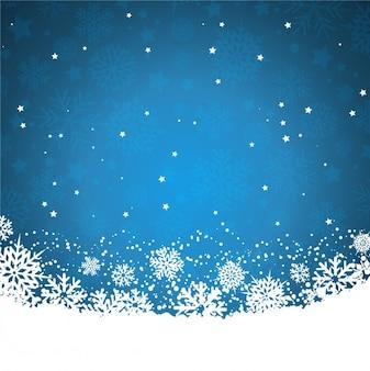 Fondo azul con copos de nieve y estrellas