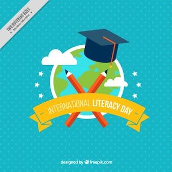 Fondo azul de mundo y birrete para el día internacional de la alfabetización