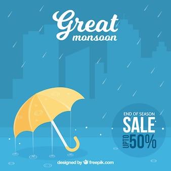 Fondo azul de rebajas de monzón de paraguas y lluvia