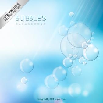 Fondo azul y burbujas brillantes