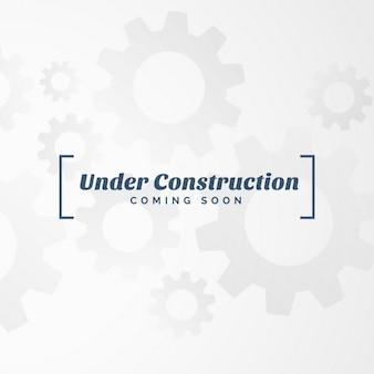 Fondo blanco con engranajes y texto  en construcción